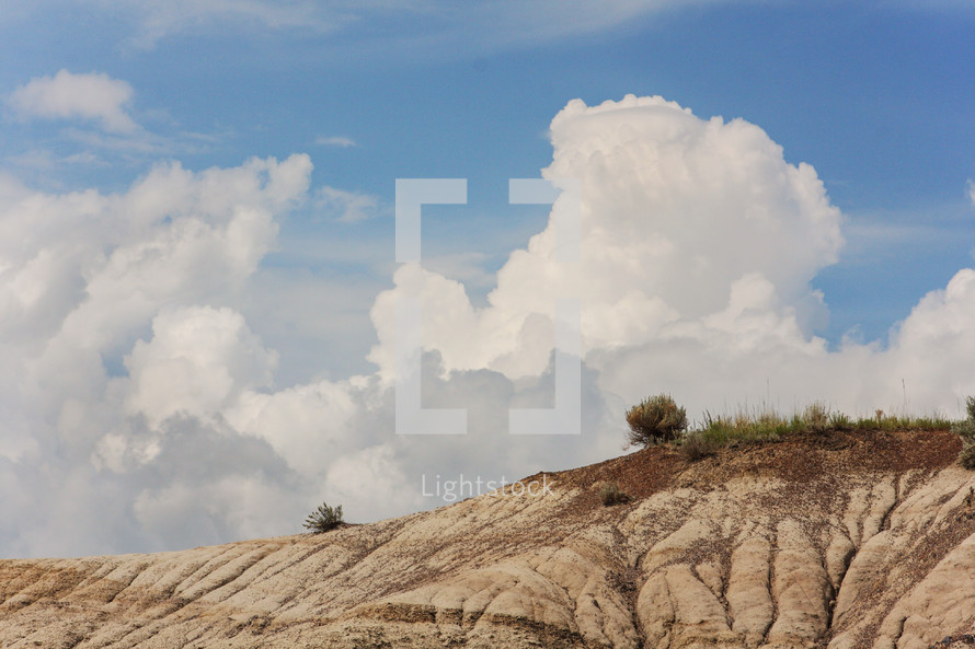 rolling dunes and clouds