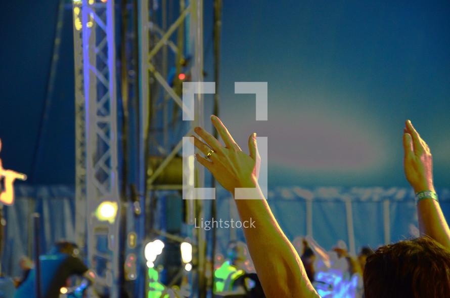 raised hands worshiping