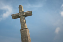 stone cross against a blue sky