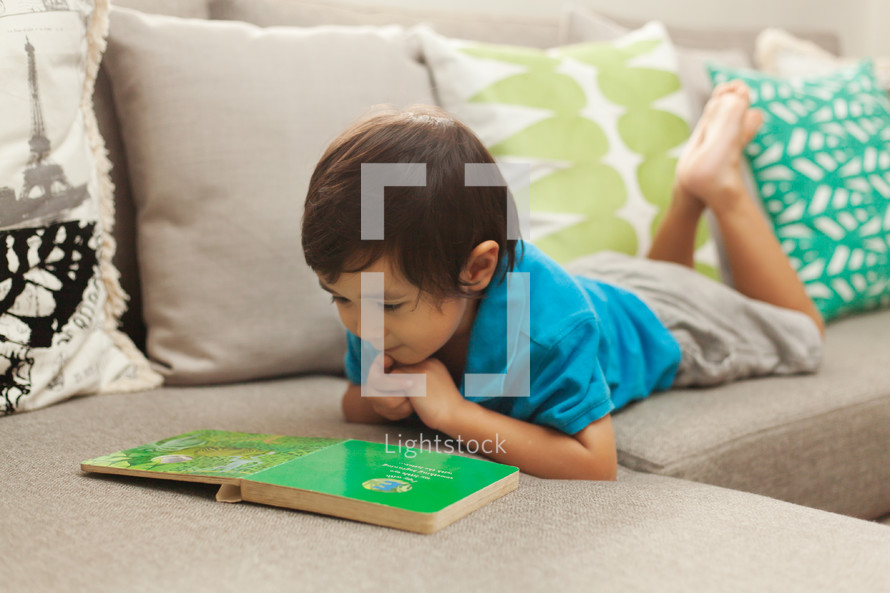 boy child reading a book
