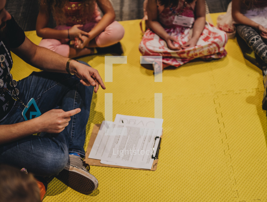children learning sitting on a floor in a circle