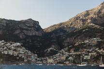 a coastal village along a slope in Italy