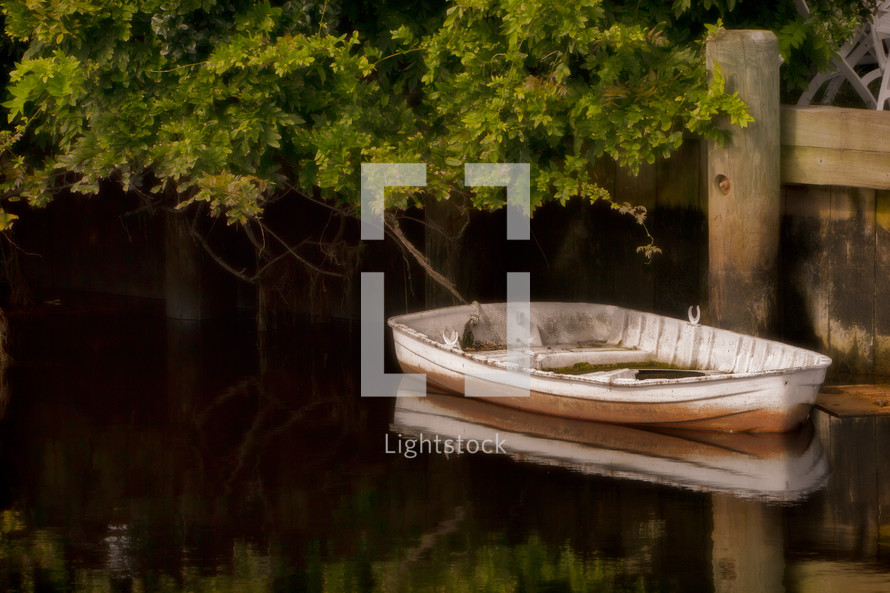 empty boat floating on a lake