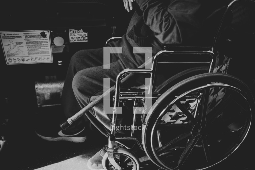 a man in a wheelchair on a city bus