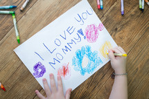 child coloring a picture - i love you mommy