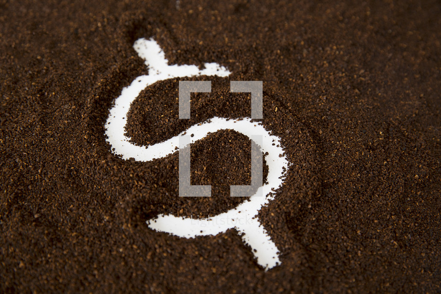 money symbol in coffee grounds