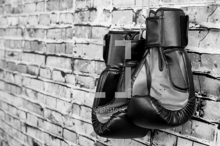 boxing gloves and a brick wall
