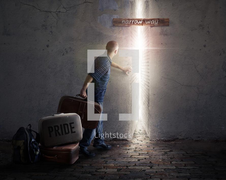 a man carrying baggage through a narrow alley