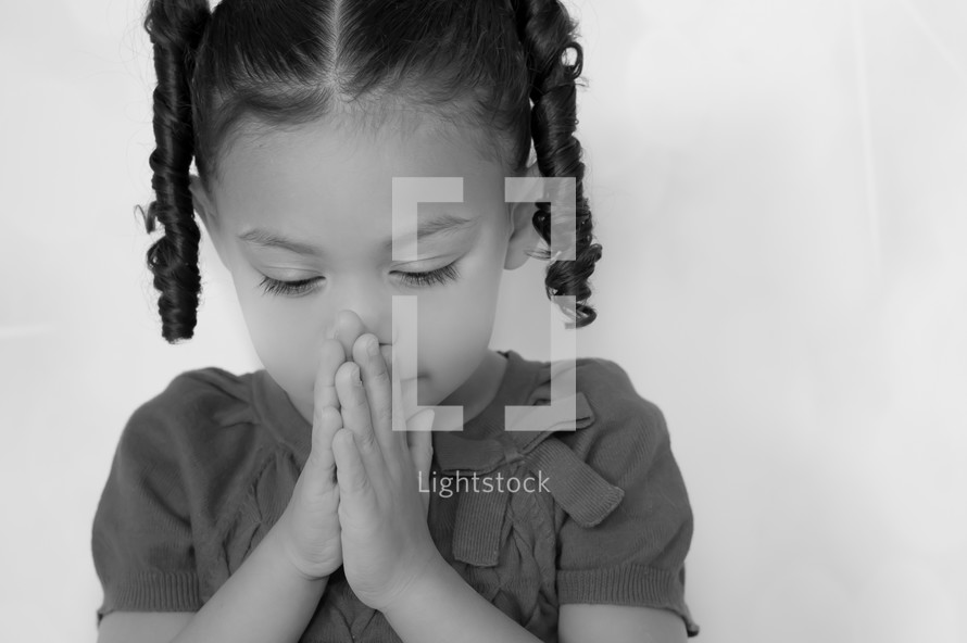 toddler in prayer