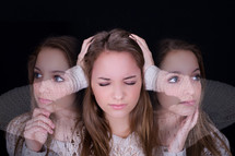 A young woman covering her ears