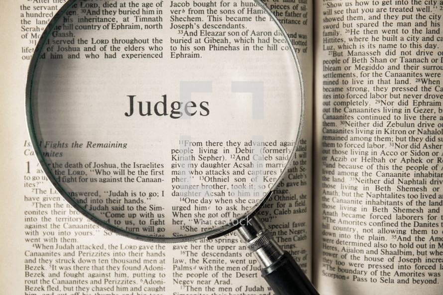 magnifying glass over Bible - Judges