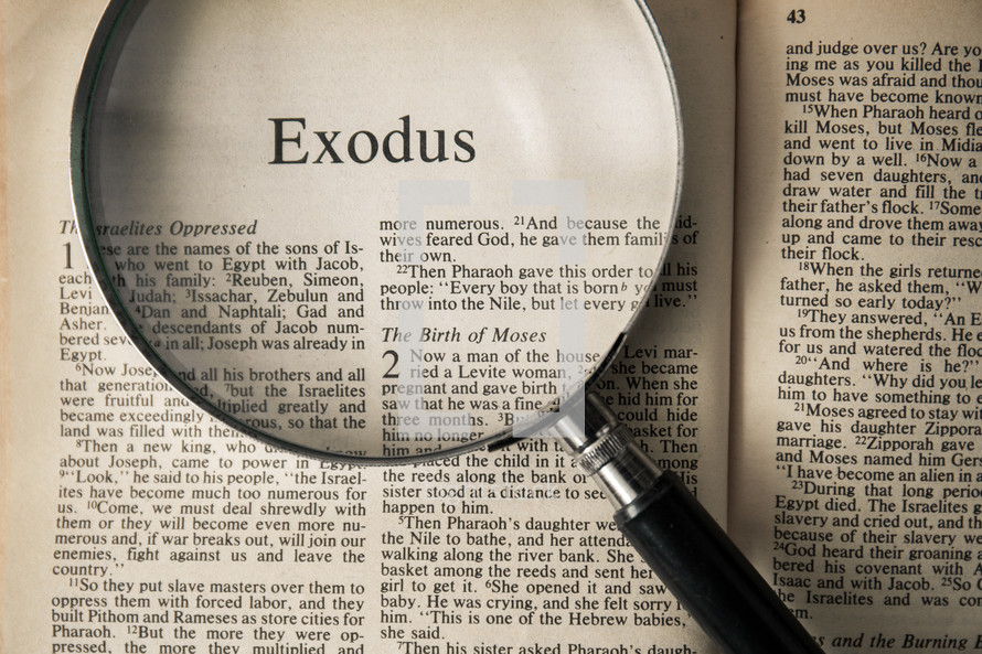magnifying glass over Bible - Exodus