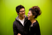 laughing Asian couple