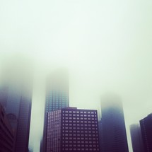 Downtown Dallas skyscraper building in fog.