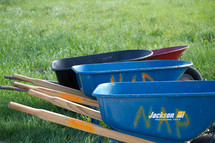 wheel barrows in the grass