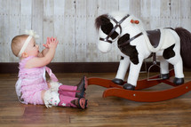infant and rocking horse