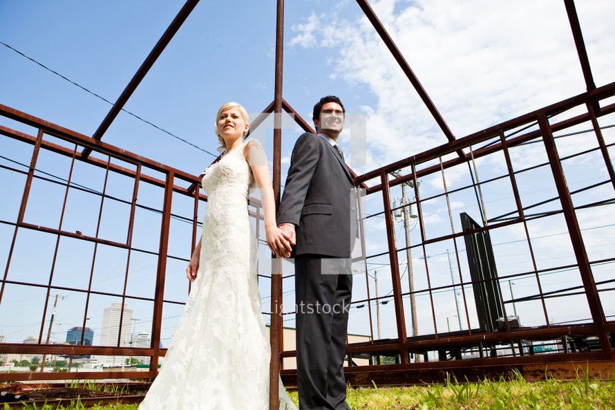 Bride and groom inside windowless structure