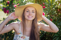 a woman in a sunhat