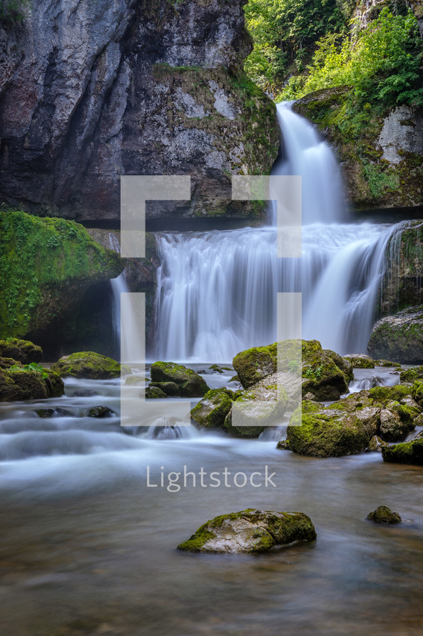 waterfall over a rock cliff