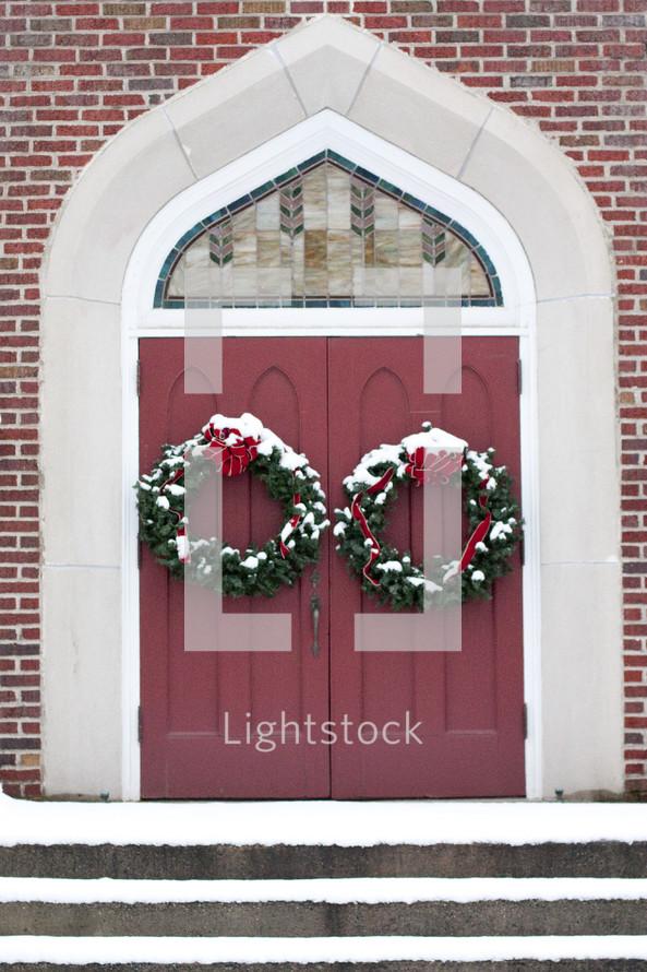 Christmas wreaths on a church's doors