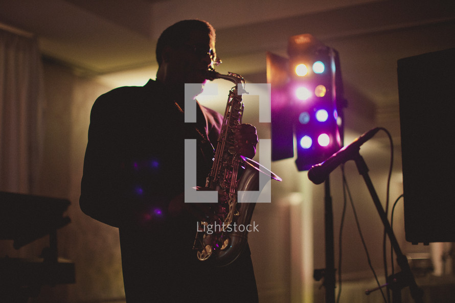 man playing a saxophone