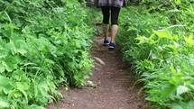 a woman walking on a trail