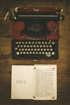 An old manual typewriter and a list of New Year's resolutions for 2014.