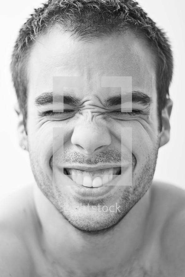 man smiling with his eyes closed