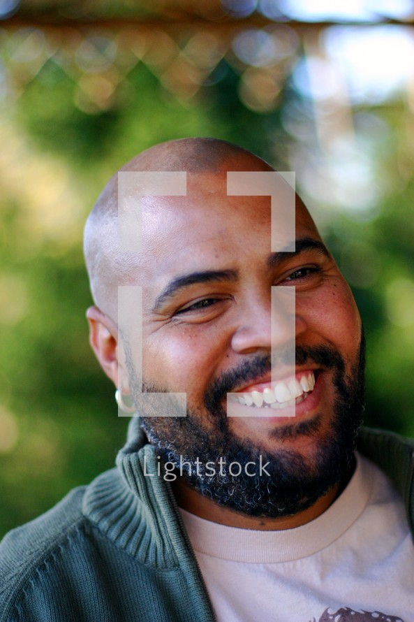 Man with goatee laughing