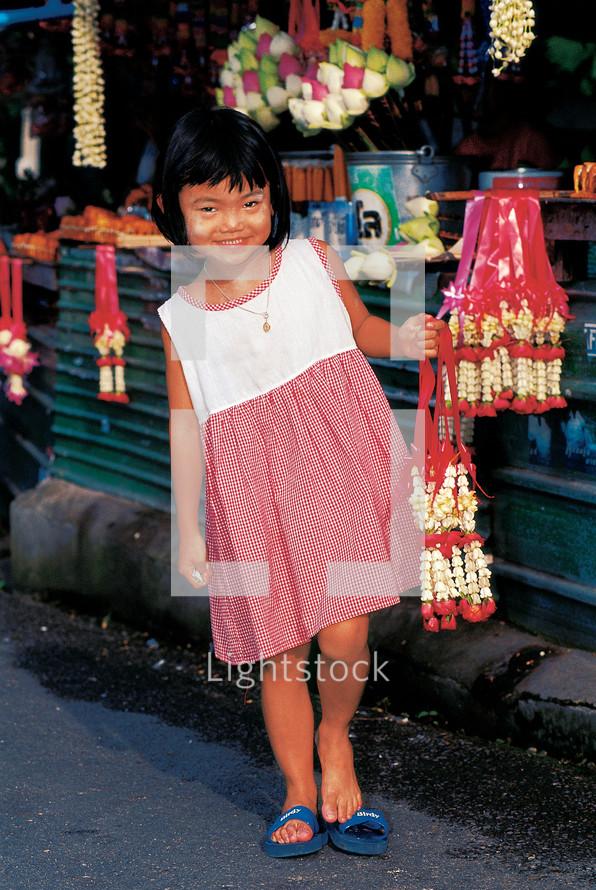 Girl child in a market in Thailand