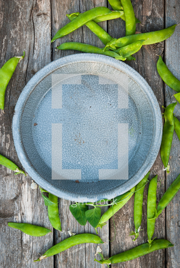 green peas and a paper plate
