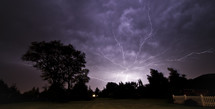 lightning streaking across the night sky