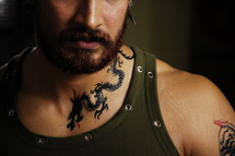 a dragon tattoo on a man's neck