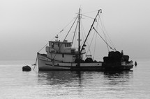 a shrimp boat on the water