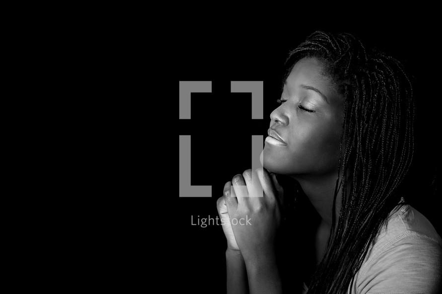 teen girl in prayer