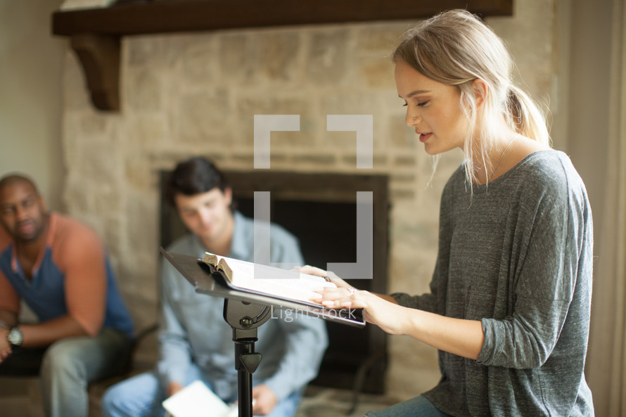 A young woman leading a home Bible study.