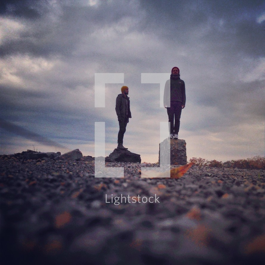 men standing on rocks