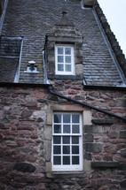 windows on a stone house
