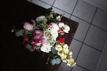 flower arrangement on a wood table