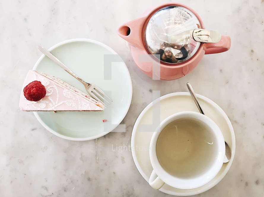 slice of cake and tea pot