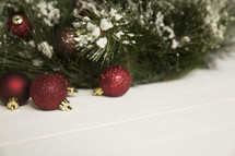glittery Christmas ornaments and Christmas tree on a white background