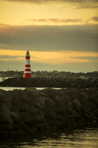 red and white lighthouse on a shore