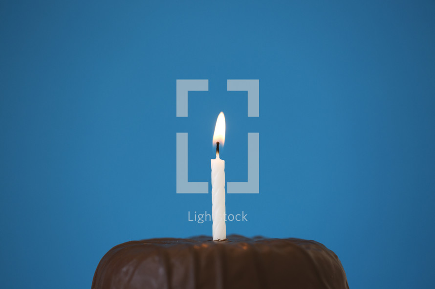 birthday candle on a chocolate cake