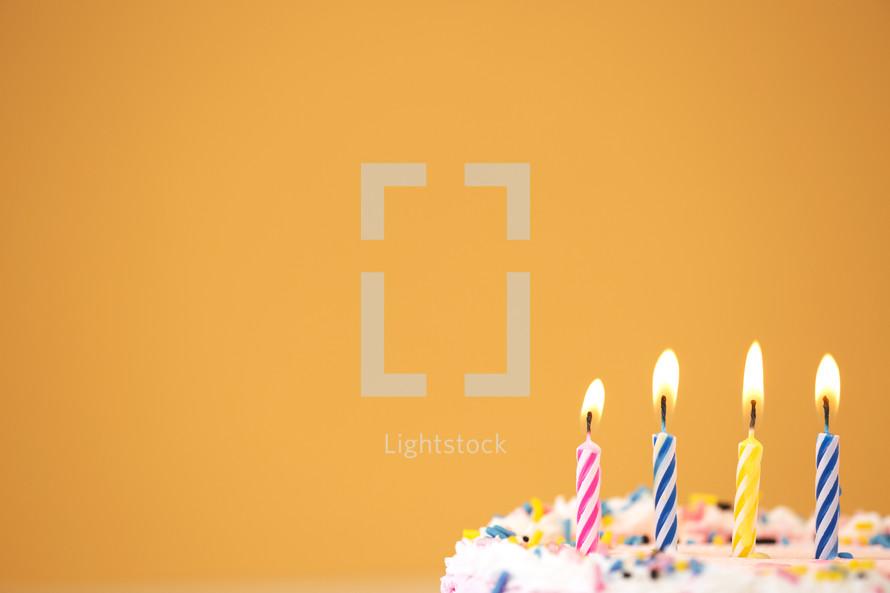 birthday candles on a birthday cake