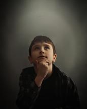 a little boy looking up
