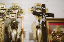 Crucifix with saint relics in a Catholic church.