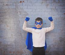 a boy dressed up like a super hero