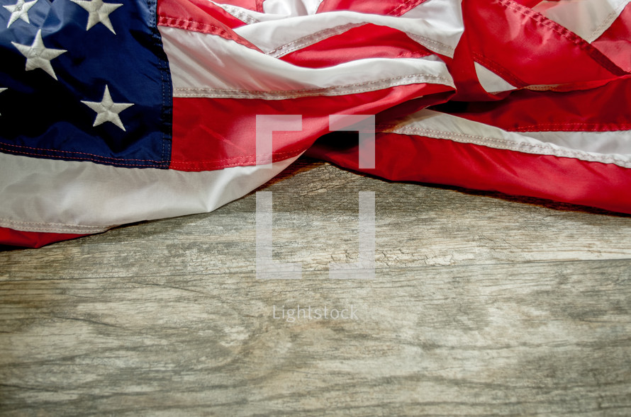 American flag and wood background