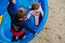 children on a slide on a playground