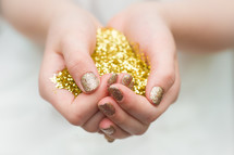 hands full of gold glitter